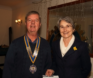 Sue Hawkett receives a cheque on behalf of Marie Curie
